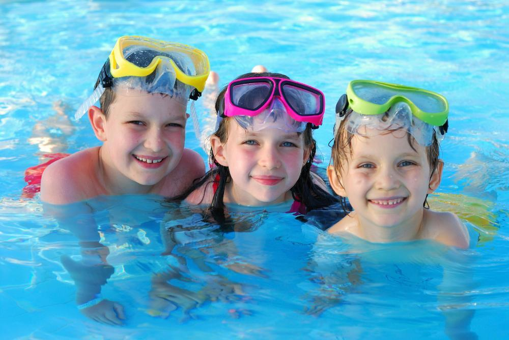 three kids swimming | Emergency Dentistry in Northborough MA