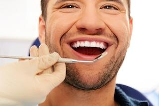 man smiling during general dentistry exam in northborough ma